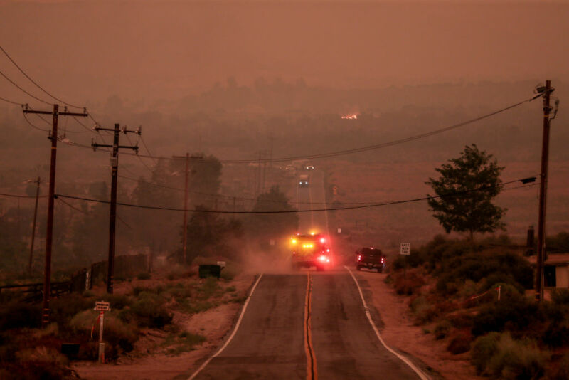 Juniper Hills, CA, Thursday, Sept. 17, 2020 - A fire engine drives into air thick with smoke along Juniper Hills Rd. as the Bobcat Fire advances North into the Antelope Valley.