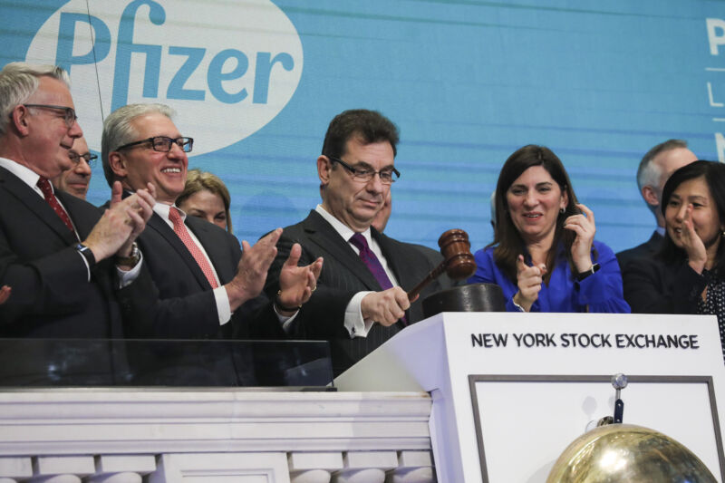 Albert Bourla, chief executive officer of Pfizer pharmaceutical company, bangs a gavel after ringing the closing bell at the New York Stock Exchange (NYSE) on Thursday afternoon, January 17, 2019 in New York City.