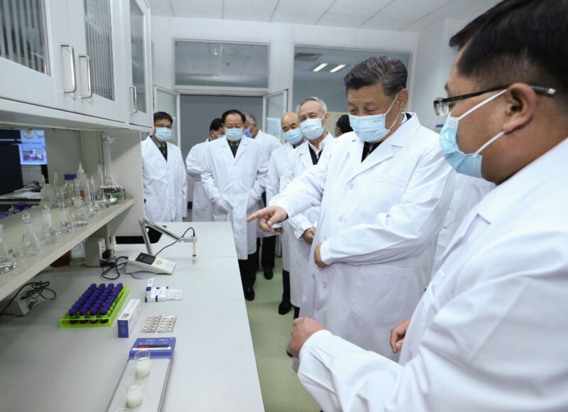 Chinese President Xi Jinping learns about the progress on a COVID-19 vaccine during his visit to the Academy of Military Medical Sciences in Beijing on March 2, 2020.