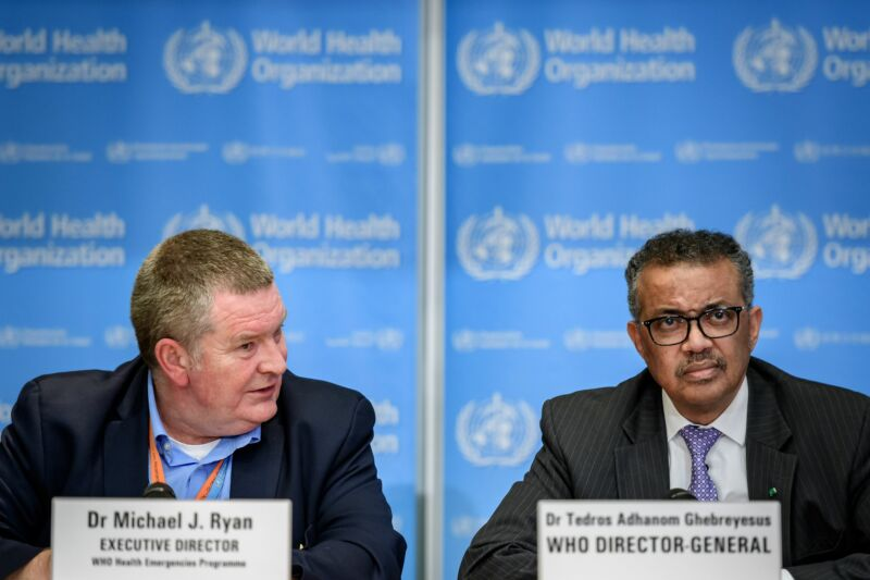 World Health Organization (WHO) Health Emergencies Program Director Michael Ryan (L) speaks past Director-General Tedros Adhanom Ghebreyesus during a daily press briefing on COVID-19 virus at the WHO headquarters in Geneva on March 9, 2020.