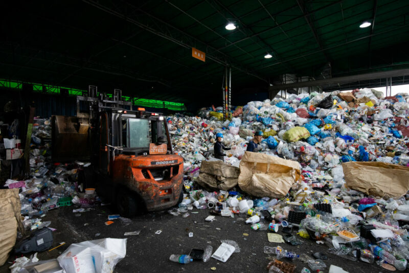 Image of a forklift surrounded by plastic bottles.