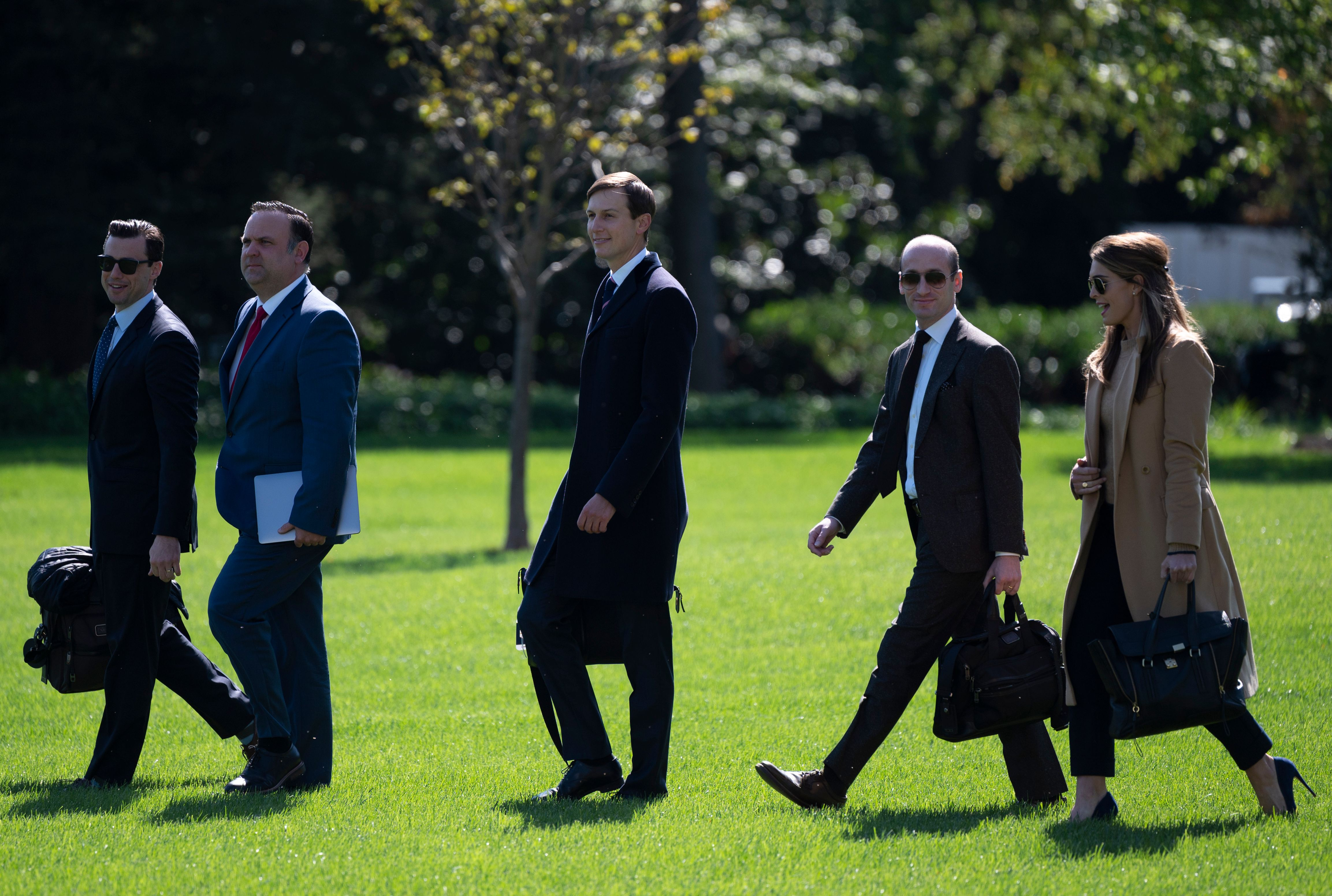 (L-R) Assistant to the President and Director of Oval Office Operations Nicholas Luna, Assistant to the President and Deputy Chief of Staff for Communications Dan Scavino, Senior Adviser to the President of the United States Jared Kushner, Senior Adviser to the President Stephen Miller, and Counselor to the President Hope Hicks walk to Marine One to depart from the South Lawn of the White House in Washington, DC, on September 30, 2020.