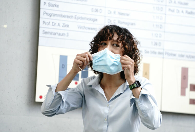 Emmanuelle Charpentier reminds everybody about pandemic safety at the start of a press conference following the announcement of her Nobel Prize.