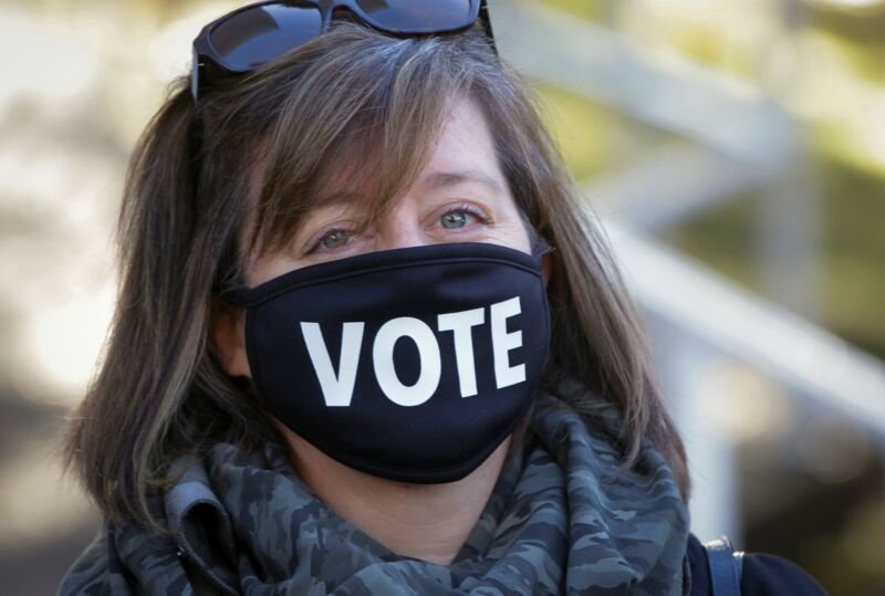 VANCOUVER, Oct. 24, 2020 - A voter wearing a face mask is seen outside a polling station during the provincial election day in Vancouver, British Columbia, Canada, Oct. 24, 2020.