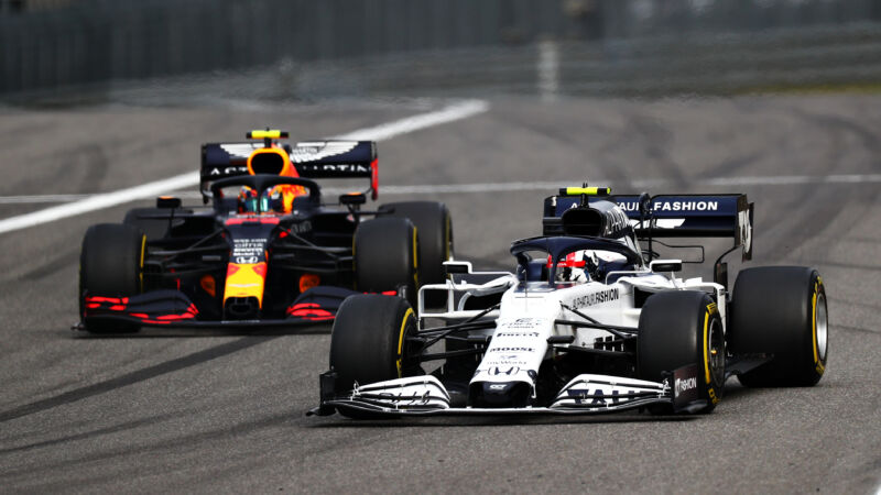 A pair of Formula 1 cars racing in close proximity