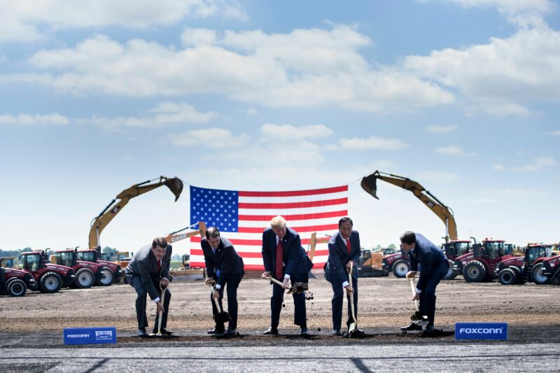 Former Wisconsin Governor Scott Walker, Donald Trump, Foxconn Chairman Terry Gou, and former House Speaker Paul Ryan participate in a groundbreaking for a Foxconn facility in Mount Pleasant, Wisconsin in 2018. Foxconn has hired significantly fewer people than it claimed it would do at the time of the company's 2017 development deal with the state.