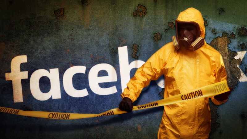 A person in a Hazmat suit covers the Facebook logo with warning tape.