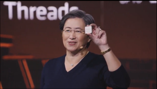 AMD CEO Lisa Su holds up a Zen 3 CPU at today's AMD Gaming event—most likely, a Ryzen 9 5900X or Ryzen 9 5950X.