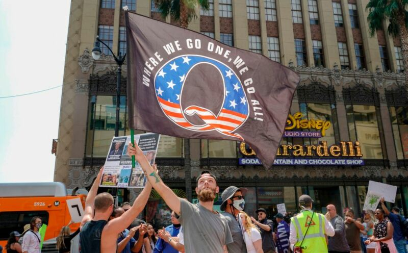 Conspiracy theorist QAnon demonstrators protest child trafficking on Hollywood Boulevard in Los Angeles, California, August 22, 2020.