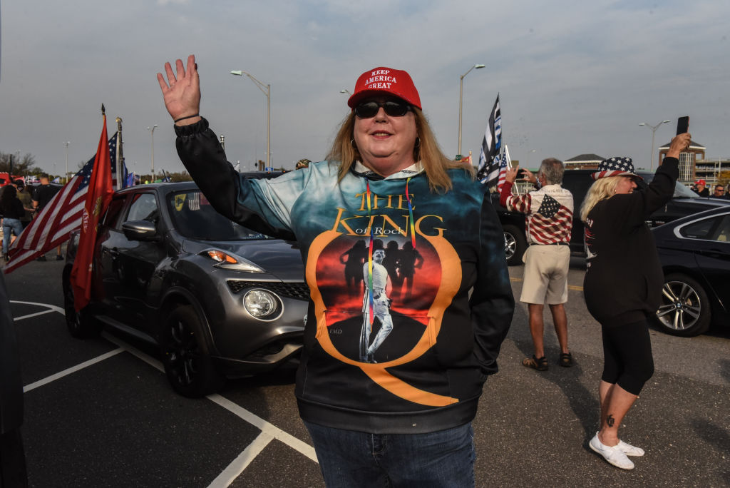 A woman wearing a sweatshirt for the QAnon conspiracy theory gestures during a pro-Trump rally on October 11, 2020 in Ronkonkoma, New York.