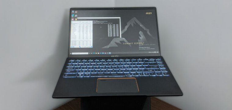 A laptop computer sits triumphant on a desk.