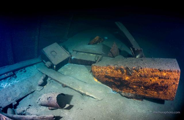 Color photo of shipwreck and cargo underwater