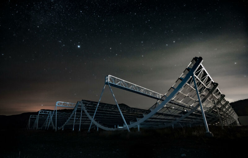 Image of a radio telescope against the night sky.
