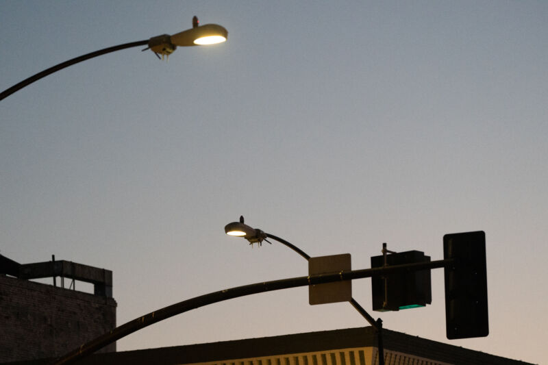 Two of San Diego's camera-equipped smart streetlights at twilight in August, 2020.