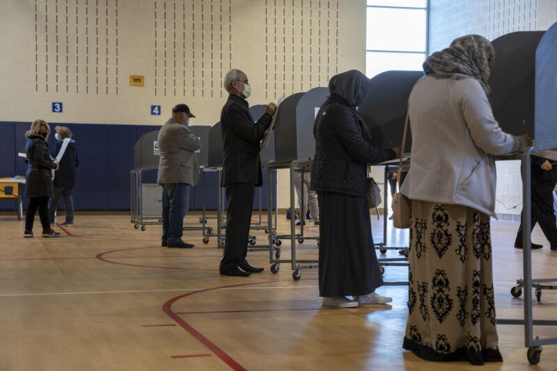 Voters in Michigan, one of the states where residents received misleading robocalls about the election, casting their ballots on November 3, 2020.