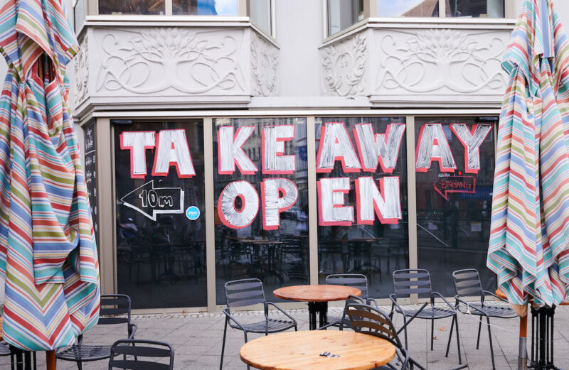 Image of a restaurant with a large sign saying
