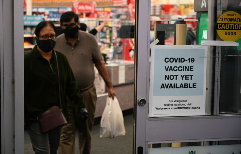 "A sign on the entrance to a pharmacy reads ""Covid-19 Vaccine Not Yet Available,"" November 23, 2020 in Burbank, California."