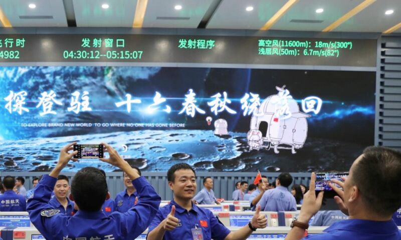 Technicians celebrate the successful launch of the Chang'e-5 spacecraft at the Wenchang Spacecraft Launch Site in south China.