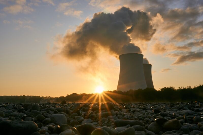 Image of two power plant cooling towers.
