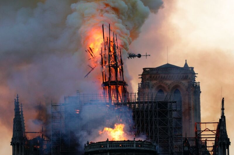 The iconic spire collapses as smoke and flames engulf the Notre Dame Cathedral in Paris on April 15, 2019.