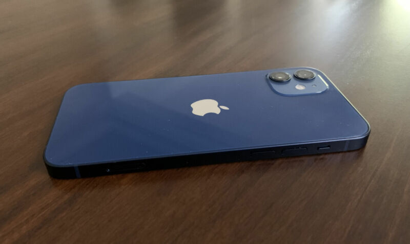 A blue smartphone sits face down on a table.