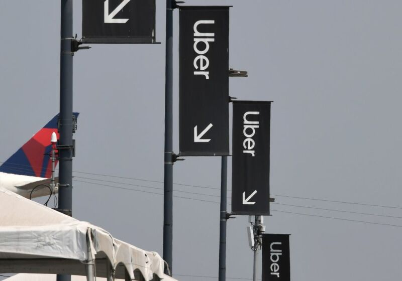 Uber signs are seen August 20, 2020 at Los Angeles International Airport in Los Angeles, California. - Rideshare service rivals Uber and Lyft were given a temporary reprieve on August 20 from having to reclassify drivers as employees in their home state of California by August 21. (Photo by Robyn Beck / AFP) (Photo by ROBYN BECK/AFP via Getty Images)