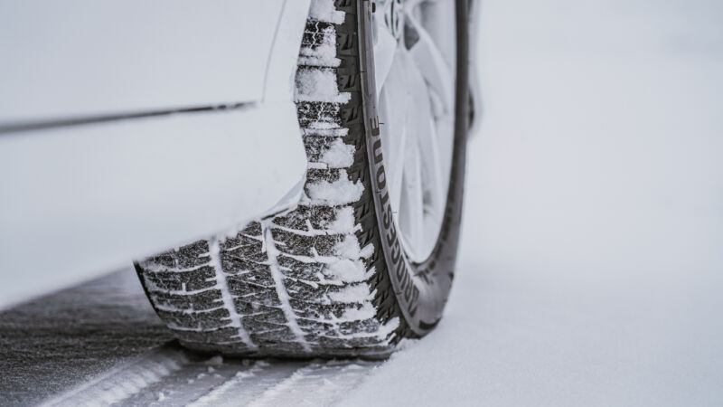 A closeup of Bridgestone's latest Blizzak tire in its natural environment.