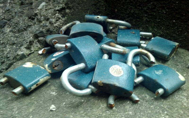 Broken padlocks piled in a corner.