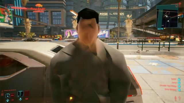 A <em>Cyberpunk</em> NPC is shown talking before his textures have fully loaded on the console version of the game.