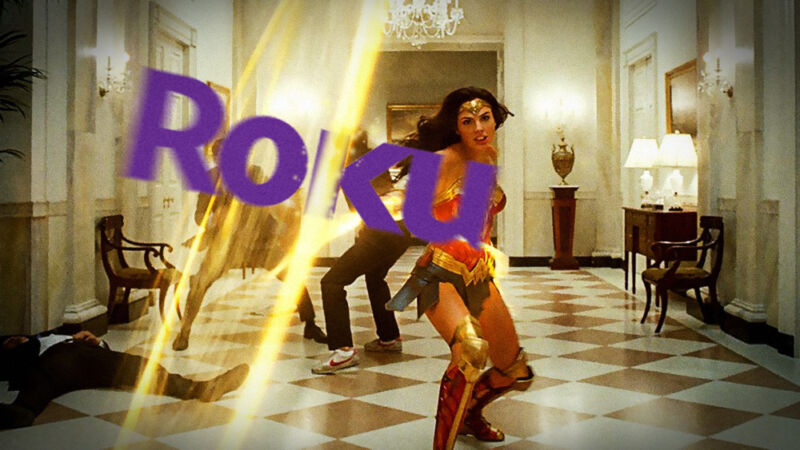 The Roku logo has been photoshopped into a screenshot from Wonder Woman in which the titular character is using her whip against henchmen.