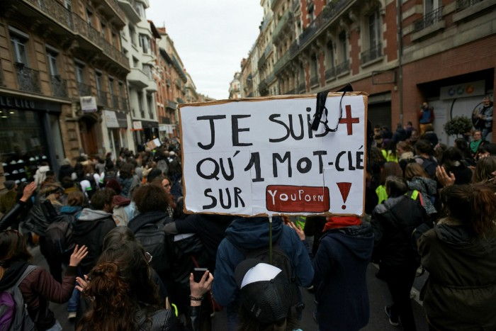 A banner at an International Women's Day march in Toulouse carries the message 'I'm more than a keyword on YouPorn.'