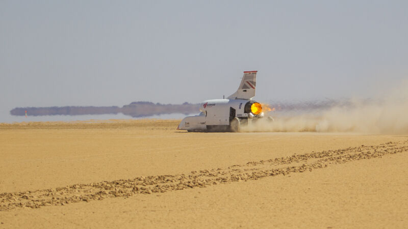 A missile car screaming across the desert.