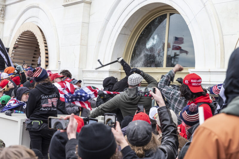 Pro-Trump protesters break windows of the Capitol building on January 6, 2021.