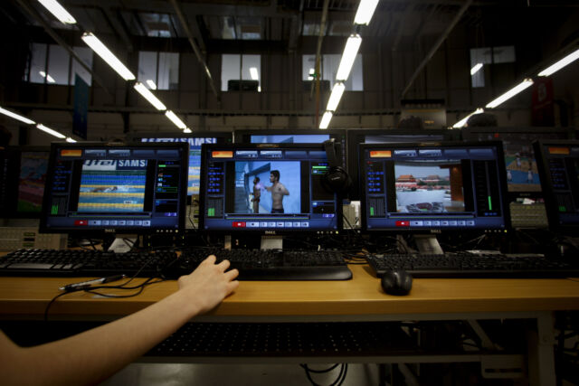 A technician works inside China Central Television's (CCTV) satellite Olympic broadcast facility for the Beijing Olympics.