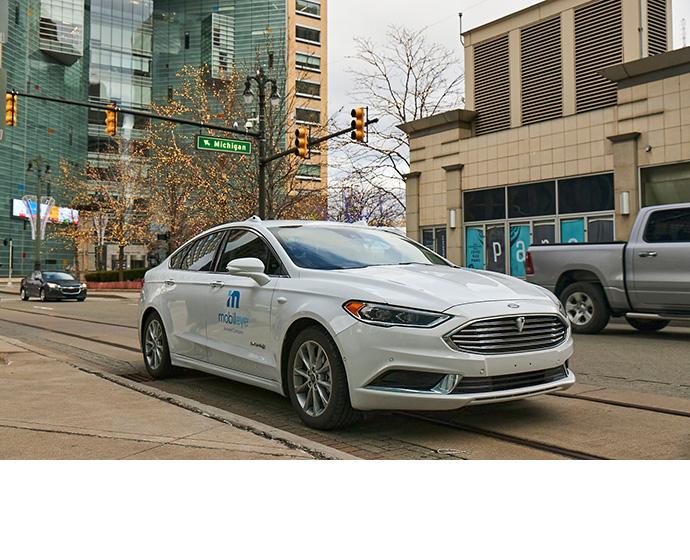 A self-driving vehicle from Mobileye's autonomous test fleet navigates the streets of Detroit.