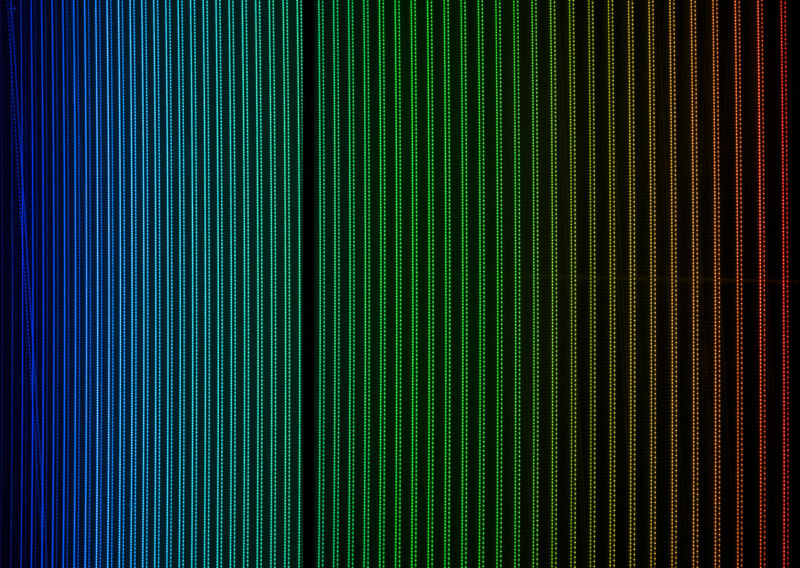 Image of a series of parallel lines in different colors.