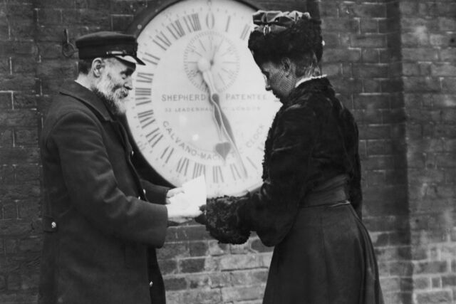 Elizabeth Ruth Belville receives a timekeeping certificate from an official at the Royal Greenwich Observatory, circa 1903.