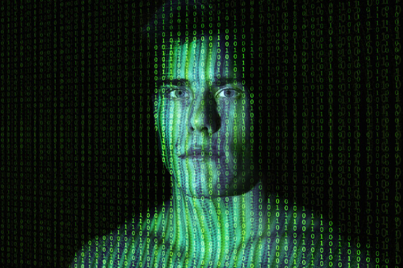 Stylized photo of a shirtless man rendered in ones and zeroes.