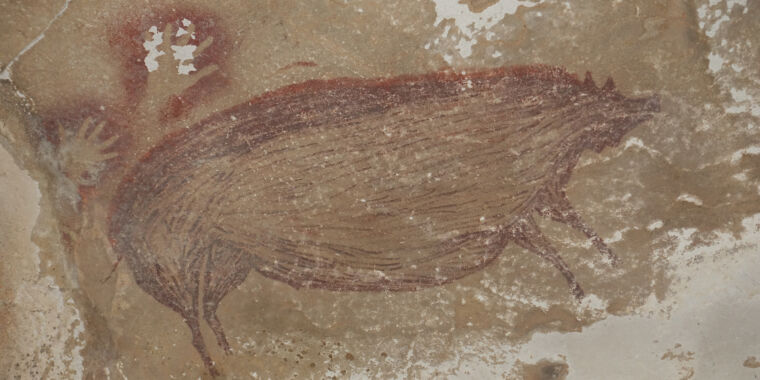 Image of article 'This painted pig is the world's oldest figurative art'