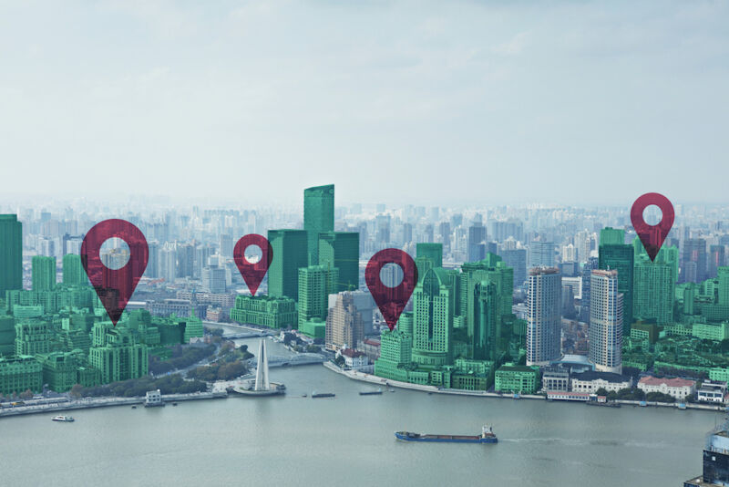 Map pin flat on green cityscape and Huangpu River