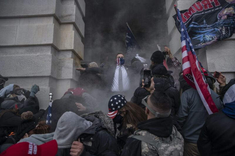 A mob of Trump supporters tries to break into the Capitol building on January 6, 2021.