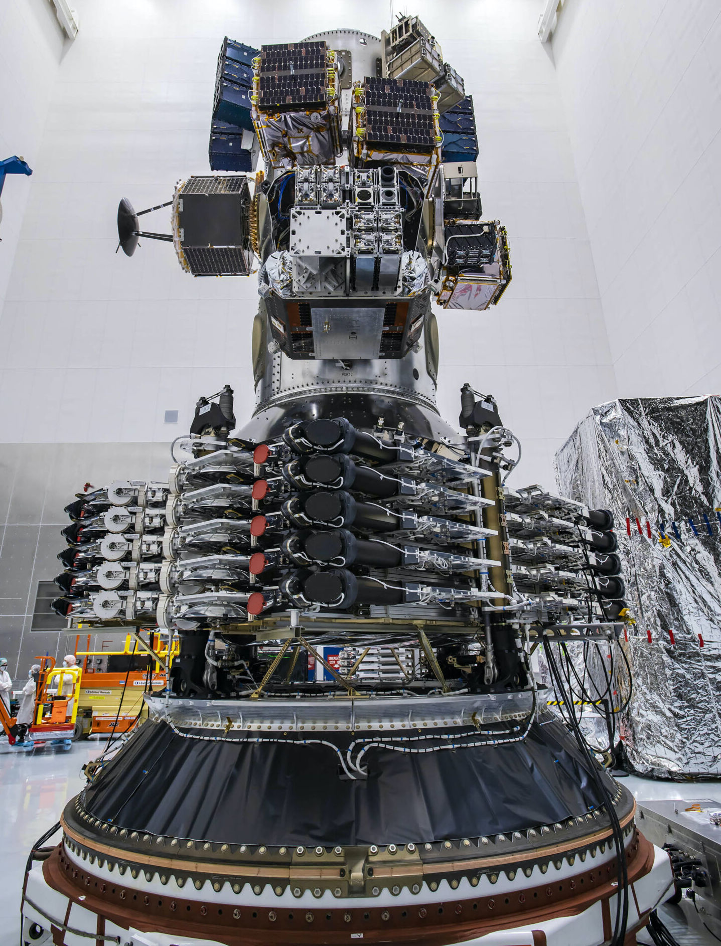 Starlink satellites prior to launch. The black circles in the middle are laser links.