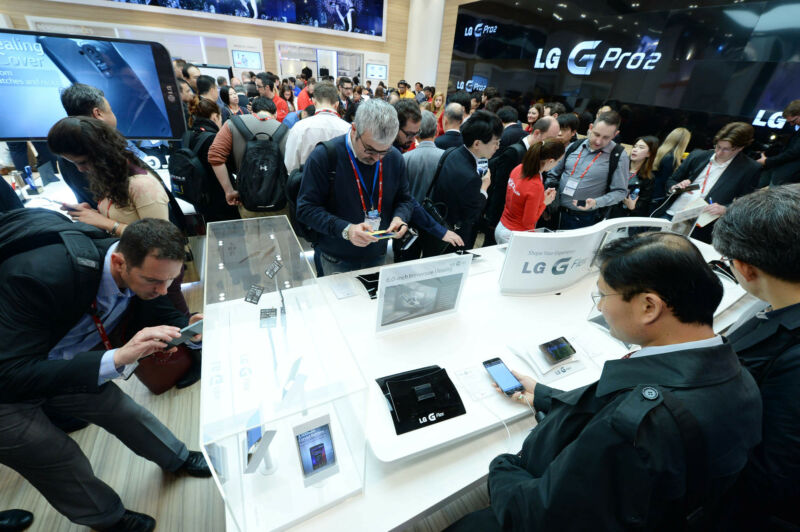 Crowds view new smartphones at a prior MWC event.