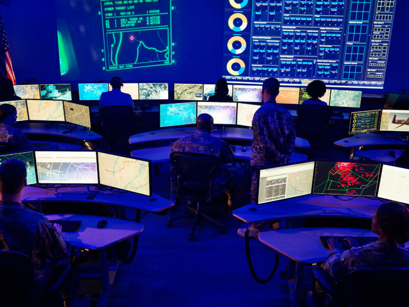 Fancy desks and cool blue lighting dominate this control room at Northrop Grumman's Colshire location.