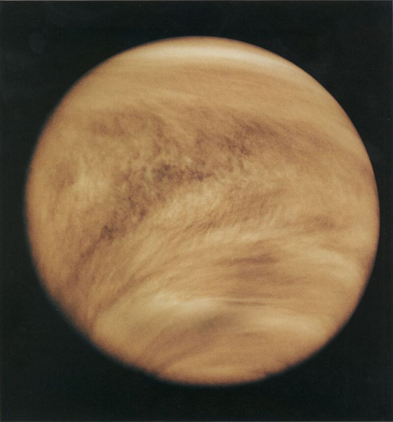 Image of a yellow-brown planet.