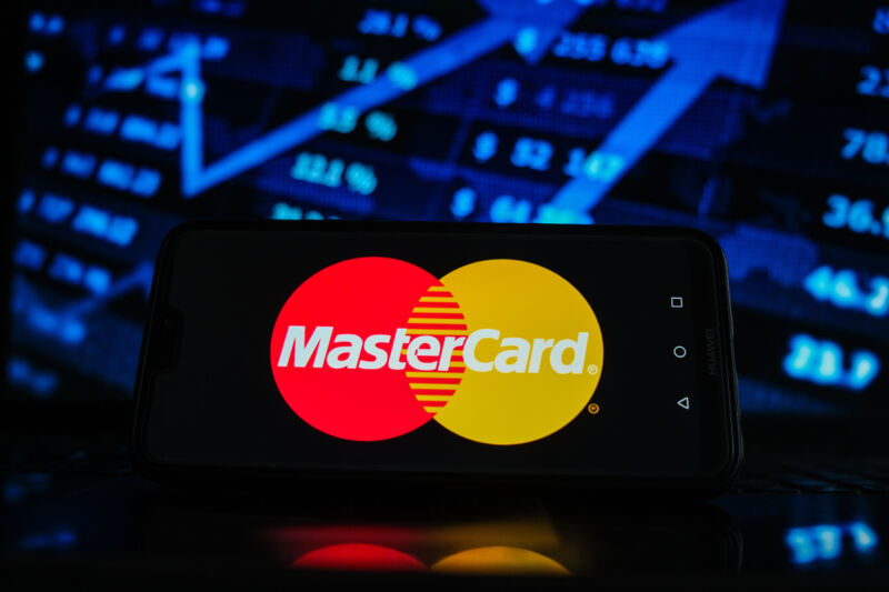 In this photo illustration a Mastercard logo seen displayed