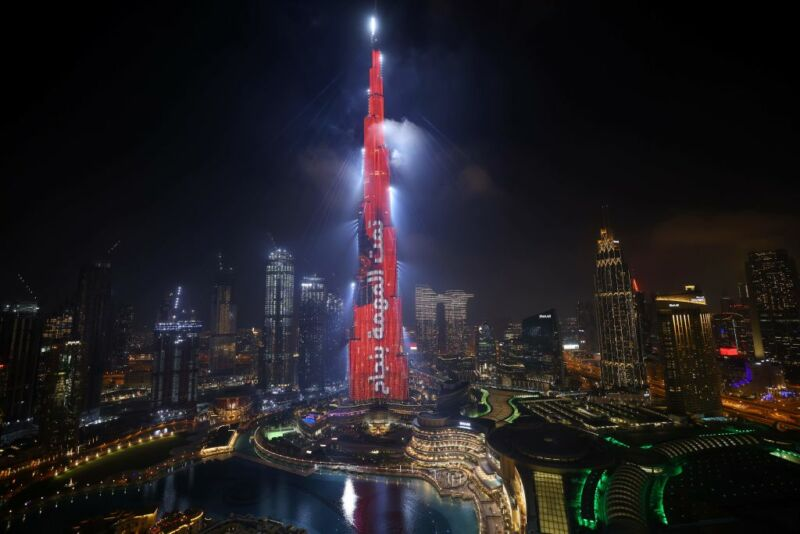 """Dubai's Burj Khalifa is lit up in red with a slogan reading in Arabic, """"Mission accomplished"""" on February 9, 2021 as the UAE's Hope probe successfully entered Mars' orbit."""