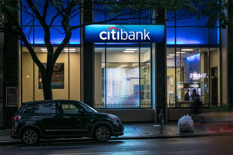 A streetside Citibank banking location at night.