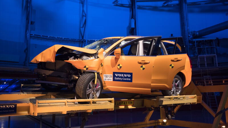 An orange Volvo SUV after a crash test.