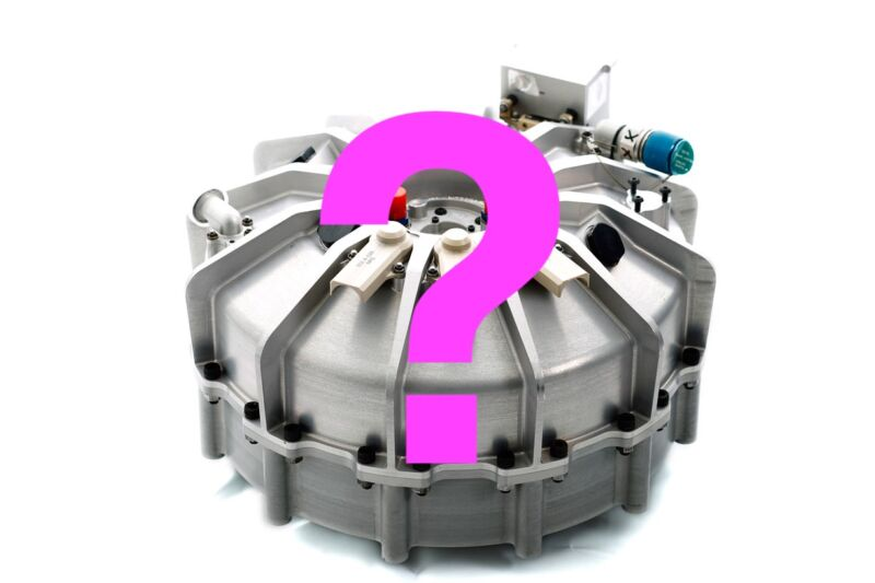 A question mark has been superimposed over a cutting edge automobile component.
